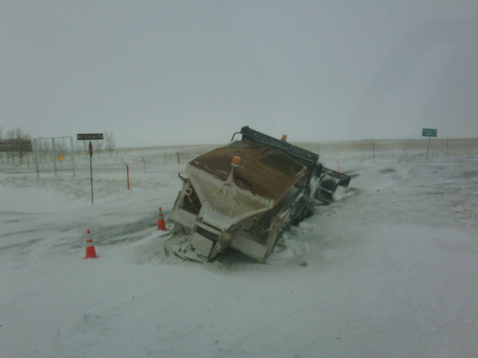 Plow stuck & leaning